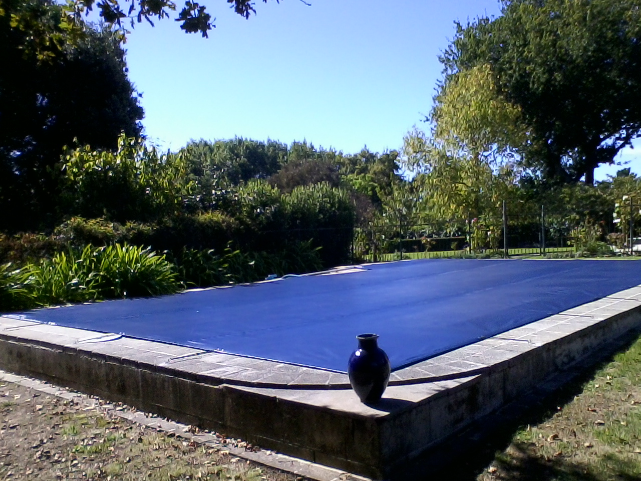 Pool sandpit covers douglas outdoor living for Garden pool with cover
